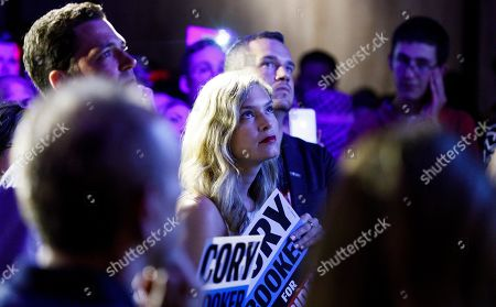 A supporter listens to Democratic presidential candidate Senator Corey Booker, of New Jersey, speak to supporters during a happy hour campaign event in New York, New York, USA, 12 August 2019.