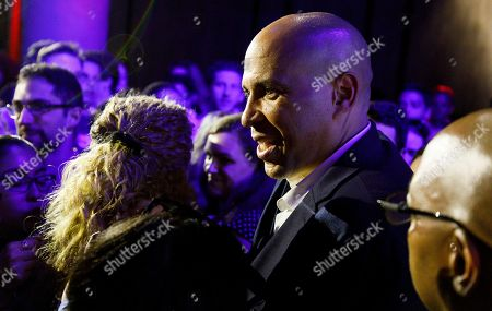 Democratic presidential candidate Senator Corey Booker (C), of New Jersey, greets supporters during a happy hour campaign event in New York, New York, USA, 12 August 2019.