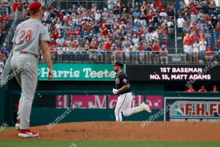 Matt Adams, Anthony DeSclafan. Washington Nationals' Matt Adams, back center, rounds the bases for his two-run home run as Cincinnati Reds starting pitcher Anthony DeSclafani (28) walks back to the mound during the first inning of a baseball game at Nationals Park, in Washington
