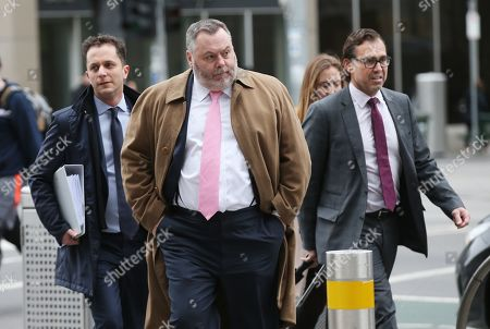 Legal representatives for Israel Folau Stuart Wood (C) and George Faros (R) arrive at the Federal Court in Melbourne, Australia, 13 August 2019. The Federal court is holding a directions hearing for Wallabies player Israel Folau, who is taking Rugby Australia to court for unfair dismissal.
