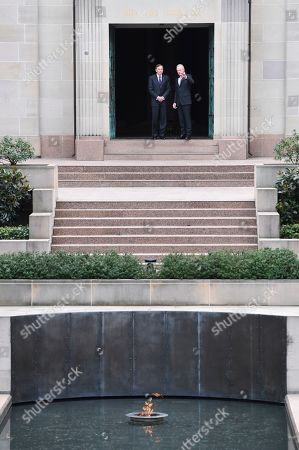 United States General (retired) David H. Petraeus (L) and Director of the Australian War Memorial Brendan Nelson (R) talk during a visit to the Australian War Memorial in Canberra, Australia, 13 August 2019.