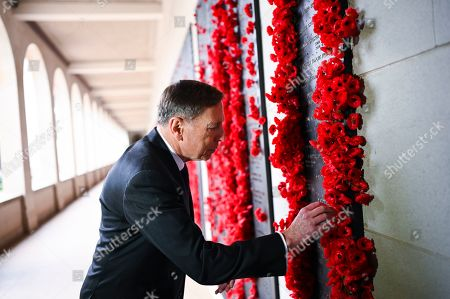United States General (retired) David H. Petraeus places a poppy at the Roll of Honour during a visit to the Australian War Memorial in Canberra, Australia, 13 August 2019.