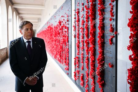 Stock Image of United States General (retired) David H. Petraeus inspects the Roll of Honour during a visit to the Australian War Memorial in Canberra, Australia, 13 August 2019.
