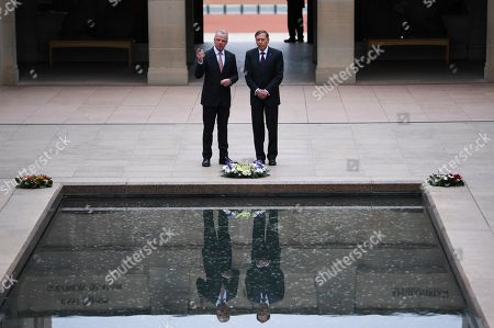 United States General (retired) David H. Petraeus (R) and Director of the Australian War Memorial Brendan Nelson (L) talk during a visit to the Australian War Memorial in Canberra, Australia, 13 August 2019.