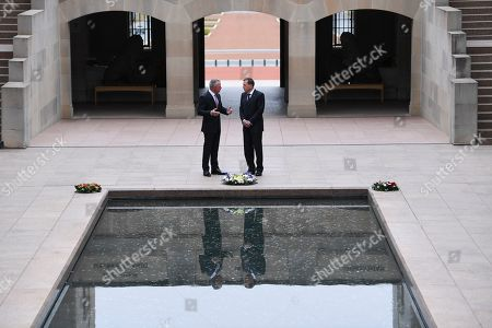 Stock Photo of United States General (retired) David H. Petraeus (R) and Director of the Australian War Memorial Brendan Nelson (L) talk during a visit to the Australian War Memorial in Canberra, Australia, 13 August 2019.