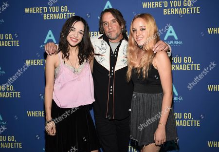 """Lorelei Linklater, Richard Linklater, Charlotte Linklater. Director Richard Linklater, center, poses with daughters Lorelei Linklater, left, and Charlotte Linklater at a special screening of """"Where'd You Go, Bernadette"""" at Metrograph, in New York"""