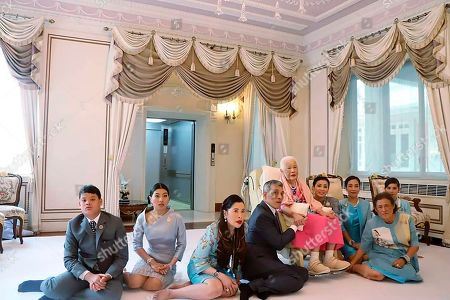Released by The Royal Household Bureau, from left, Prince Dipangkorn Rasmijoti, Princess Sirivannavari Nariratana, Princess Chulabhorn, King Maha Vajiralongkorn, Queen Mother Sirikit, Queen Suthida, Princess Bajrakitiyabha, Princess Maha Chakri Sirindhorn and Sirikitiya Jensen pose for a photograph at the Chitralada Palace on the queen's 87th birthday in Bangkok, Thailand