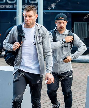 Liverpool players James Milner (L) and Xherdan Shaqiri (R) arrive at John Lennon Airport in Liverpool, Britain, 13 August 2019, upon their team's departure to Istanbul, Turkey. Liverpool FC will face Premier League rivals Chelsea FC in the UEFA Super Cup soccer match in the Besiktas Park stadium in Istanbul on 14 August 2019.