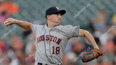 Houston Astros starting pitcher Aaron Sanchez throws a pitch to a Baltimore Orioles batter during the first inning of a baseball game, in Baltimore