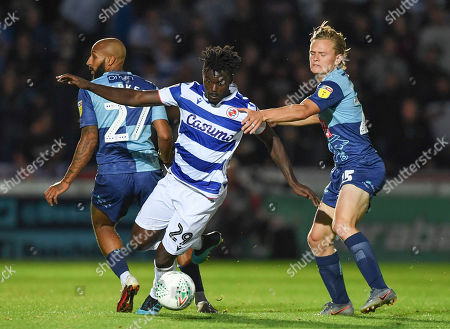 Judson Gomes of Reading turns Josh Parker of Wycombe Wanderers and Alex Samuel of Wycombe Wanderers