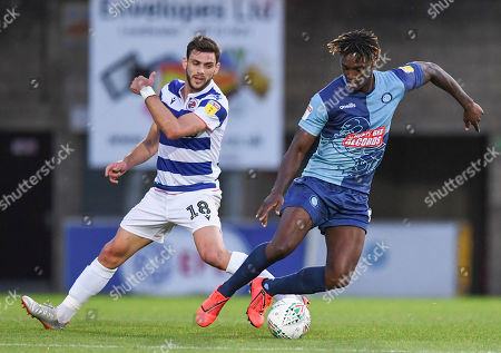 Anthony Stewart of Wycombe Wanderers under pressure from Lucas Boye of Reading
