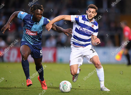 Lucas Boye of Reading under pressure from Anthony Stewart of Wycombe Wanderers