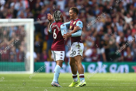 Douglas Luiz of Aston Villa celebrates scoring his sides first goal with Jack Grealish