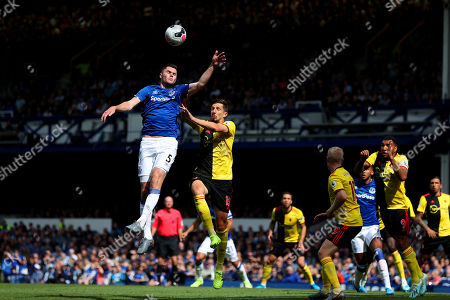 Michael Keane of Everton and Craig Cathcart of Watford compete for the ball