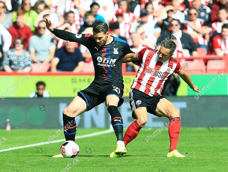 Stock Photo of Connor Wickham of Crystal Palace and Phil Jagielka of Sheffield United