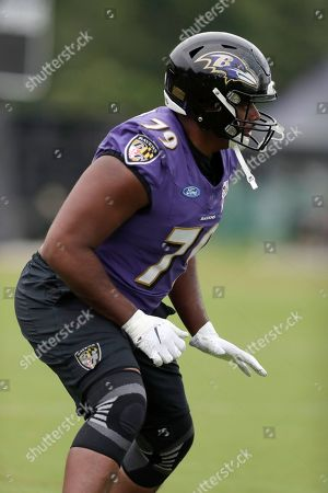 Baltimore Ravens offensive tackle Ronnie Stanley runs a drill during NFL football training camp, in Owings Mills, Md