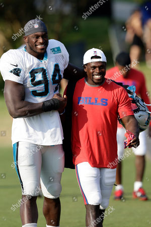 Efe Obada, Christian Wade. Carolina Panthers' Efe Obada (94) and Buffalo Bills' Christian Wade take the field together during a joint NFL football training camp in Spartanburg, S.C