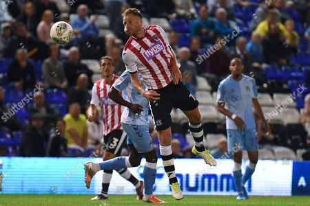 Exeter City defender Gary Warren (16) heads the ball during the EFL Cup match between Coventry City and Exeter City at the Trillion Trophy Stadium, Birmingham