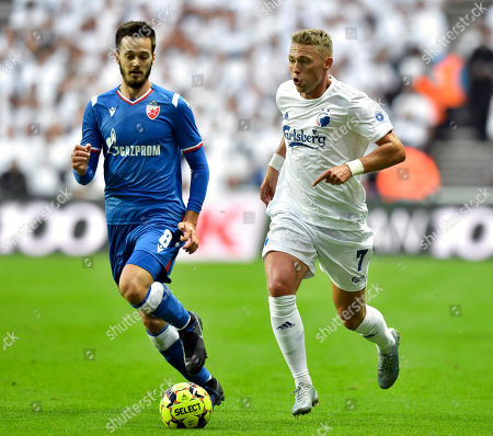 Viktor Fischer of FC Copenhagen (R) and Mirko Ivanic, Red Star (8) vies for the ball during their UEFA Champions League third qualifying round second leg soccer match between FC Copenhagen and Red Star Belgrade in Copenhagen, Denmark 13 August 2019.
