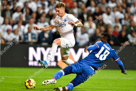 Guillermo Varela of FC Copenhagen (L) and Jander Ribeiro Santana Santana of Red Star (18) vies for the ball during their UEFA Champions League third qualifying round second leg soccer match between FC Copenhagen and Red Star Belgrade in Copenhagen, Denmark 13 August 2019.