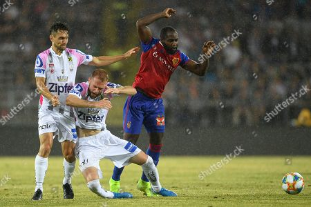 LASK'S James Holland (L) and LASK'S Joao Klauss de Mello (C) in action against Basel's Eder Balanta (R) during the UEFA Champions League third qualifying round, second leg soccer match between LASK and FC Basel, in Linz, Austria, 13 August 2019.