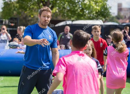 Jonny Wilkinson coaches children at touch rugby on Bristol Harbourside.