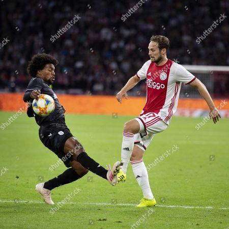 Diego Biseswar of PAOK Saloniki (L) causes a penalty by handling the ball against Daley Blind of Ajax Amsterdam during the UEFA Champions League third qualifying round, second leg soccer match between Ajax Amsterdam and PAOK Saloniki, in Amsterdam, The Netherlands, 13 August 2019.
