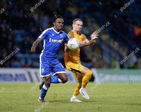 Stock Picture of Taylor Maloney of Newport is challenged by Gillingham's Regan Charles-Cook.