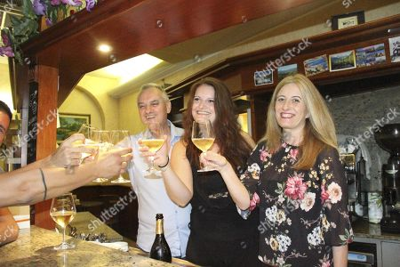 Owners of the Marino's bar, Guglielmo Poggi (L), Sara Poggi (C) and Marisa Casarini (R), celebrate after the winning ticket in the 'SuperEnalotto lottery was purchased at the bar in Lodi, Italy, 13 August 2019. The value of the winning ticket is 209 million euro.