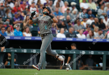 R m. Arizona Diamondbacks' David Peralta gesture as he circles the bases after hitting a two-run home run off Colorado Rockies starting pitcher Jeff Hoffman in the second inning of a baseball game, in Denver