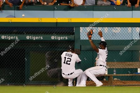 Brandon Dixon, Niko Goodrum. Detroit Tigers left fielder Brandon Dixon (12) and center fielder Niko Goodrum run into each other after Goodrum misplayed a two-run home run by Seattle Mariners' Kyle Seager during the ninth inning of a baseball game, in Detroit