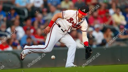 Stock Image of Atlanta Braves third baseman Josh Donaldson (20) fields a ground ball from New York Mets' Amed Rosario in the first inning of a baseball game, in Atlanta
