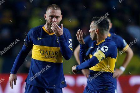 Daniele De Rossi (L) and Carlos Tevez (R) of Boca Juniors react during the Copa Argentina soccer match between Boca Juniors and Almagro at the Ciudad de La Plata stadium in Buenos Aires, Argentina, 13 August 2019.