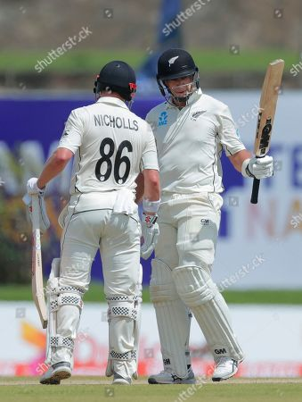 Stock Picture of New Zealand's Henry Nichols, left, congratulates teammate Ross Taylor for scoring a half century during the day one of the first test cricket match between Sri Lanka and New Zealand in Galle, Sri Lanka