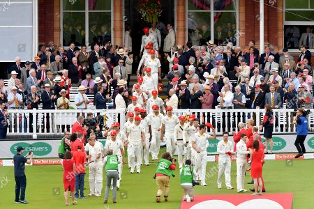 England and Australian players wear red caps in memory of Andrew Strauss' wife Ruth during the second day of the second Specsavers Ashes series at Lord's cricket ground, London, UK