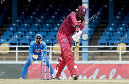 West Indies opening batsman Chris Gayle defends his wicket on the third One-Day International cricket match against India in Port of Spain, Trinidad