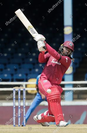 West Indies opening batsman Chris Gayle hit a four during the third One-Day International cricket match against India in Port of Spain, Trinidad