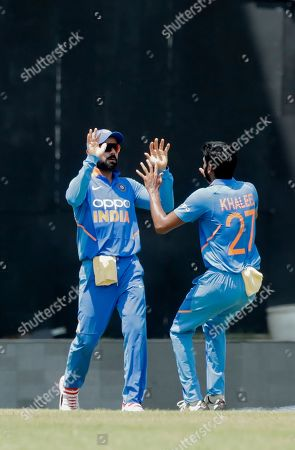 India captain Virat Kohli, left, celebrate with teammate Khaleel Ahmed, the dismissal of West Indies Chris Gayle who was caught out by Kohli for 72 runs, during the third One-Day International cricket match in Port of Spain, Trinidad
