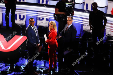 Don Lemon, Dana Bash and Jake Tapper look into the audience before the first of two Democratic presidential primary debates hosted by CNN, in the Fox Theatre in Detroit