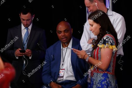 Charles Barkley watches in the spin room after the first of two Democratic presidential primary debates hosted by CNN, in the Fox Theatre in Detroit