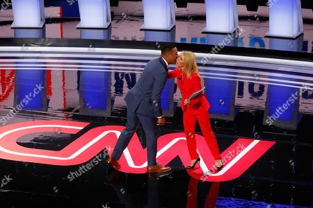 Don Lemon kisses Dana Bash during introductions before the first of two Democratic presidential primary debates hosted by CNN, in the Fox Theatre in Detroit