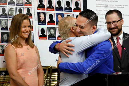 Bridie Farrell, Joseph Caramanno, Jeff Anderson, Pat Stoneking. Sexual abuse victim Bridie Farrell, left, and attorney Patrick Stoneking, right, watch as fellow abuse victim Joseph Caramanno, second right, hugs attorney Jeff Anderson during a news conference, in New York, . Wednesday marked the start of a one-year litigation window in New York allowing people to file civil lawsuits that had previously been barred by the state's statute of limitations, which was one of the nation's most restrictive before lawmakers relaxed it this year