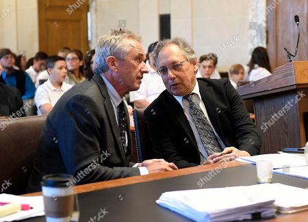 Attorneys Robert F. Kennedy, Jr.,left, and Michael H. Sussman talk before a hearing challenging the constitutionality of the state legislature's repeal of the religious exemption to vaccination on behalf of New York state families who held lawful religious exemptions, at the Albany County Courthouse, in Albany, N.Y