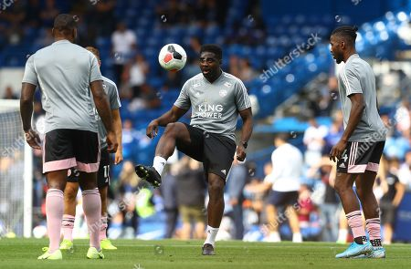 Leicester City coach Kolo Toure joins in the warm up
