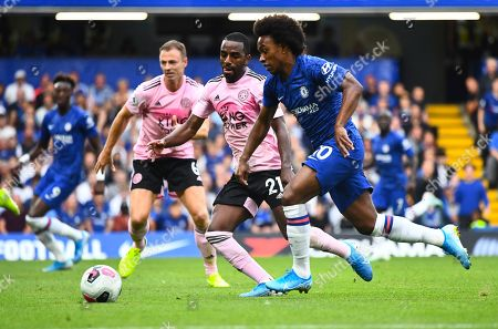 Stock Photo of Willian of Chelsea watched by Jonny Evans, left, and Ricardo Pereira of Leicester City