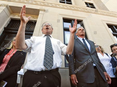 Attorneys Michael H. Sussman,left, and Robert F. Kennedy, Jr. speak after a hearing challenging the constitutionality of the state legislature's repeal of the religious exemption to vaccination on behalf of New York state families who held lawful religious exemptions, during a rally outside the Albany County Courthouse, in Albany, N.Y