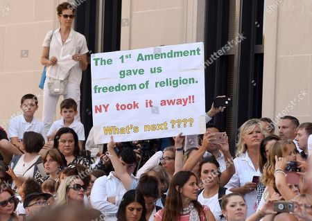 People wait in line to hear Attorneys Michael H. Sussman and Robert F. Kennedy, Jr. speak at a hearing challenging the constitutionality of the state legislature's repeal of the religious exemption to vaccination on behalf of New York state families who held lawful religious exemptions, during a rally outside the Albany County Courthouse, in Albany, N.Y