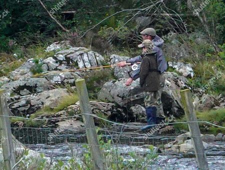 Sophie Wessex's son James Viscount Severn learning to fly fish on the River Dee