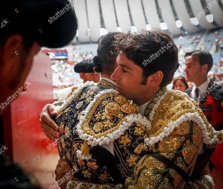 Spain's bullfighter Cayetano Rivera (R) greets colleague Jose Maria Manzanares (L) prior to taking the bullring at San Sebastian's Fair bullfighting at Illumbe bullring in San Sebastian, Basque Country, Spain, 14 August 2019.