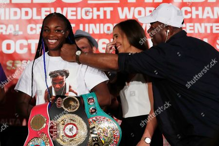 Claressa Shields, Ivana Habazin, Bashir Ali. Bashir Ali, right, trainer of Ivana Habazin, center, playfully jabs Claressa Shields during a press conference, in Detroit. The women will fight on Oct. 5 for the vacant WBO Junior Middleweight title in Flint, Mich